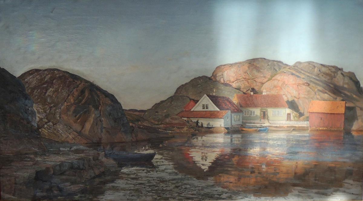 Skjærgård med hus og båter.