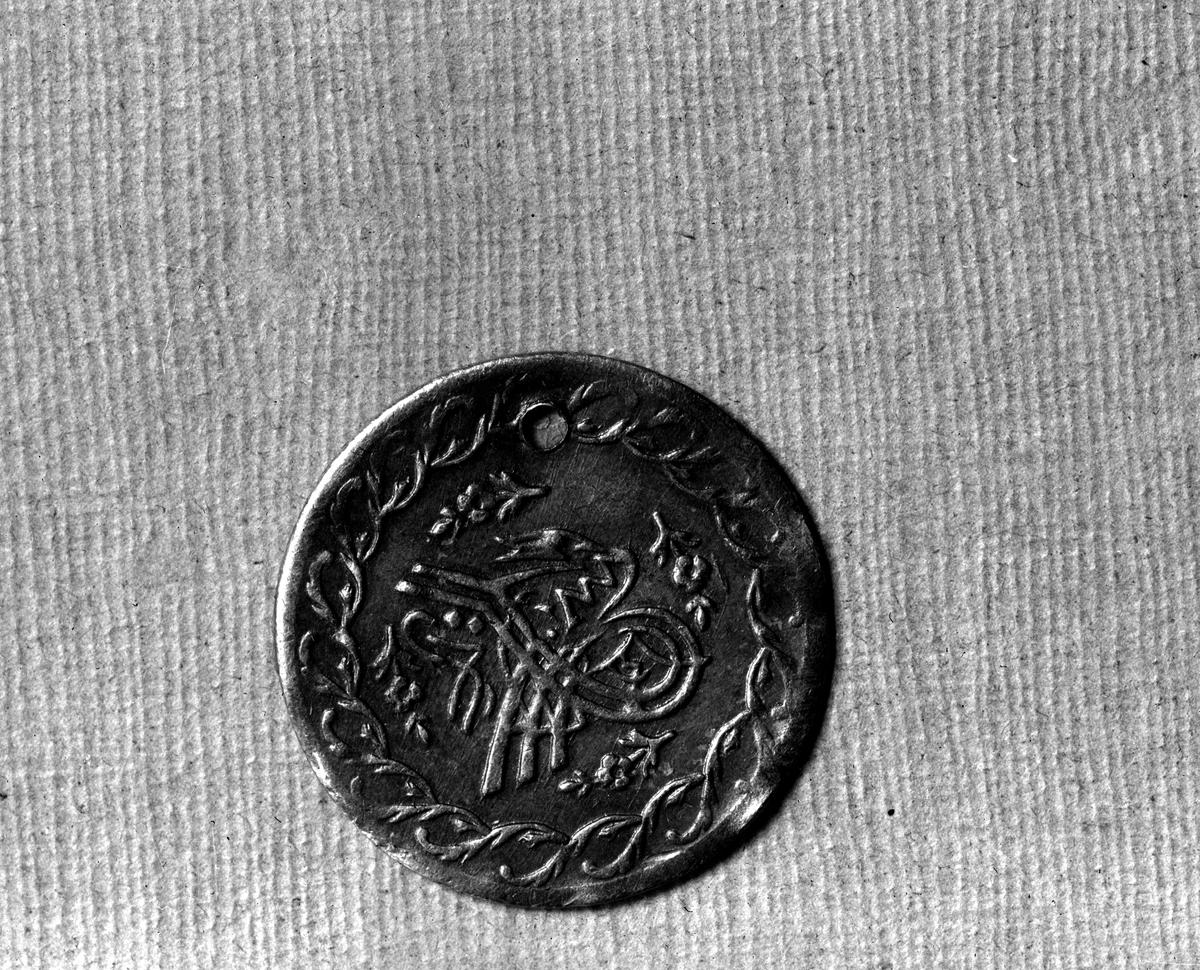 Arabiskt mynt. Fotograf okänd.