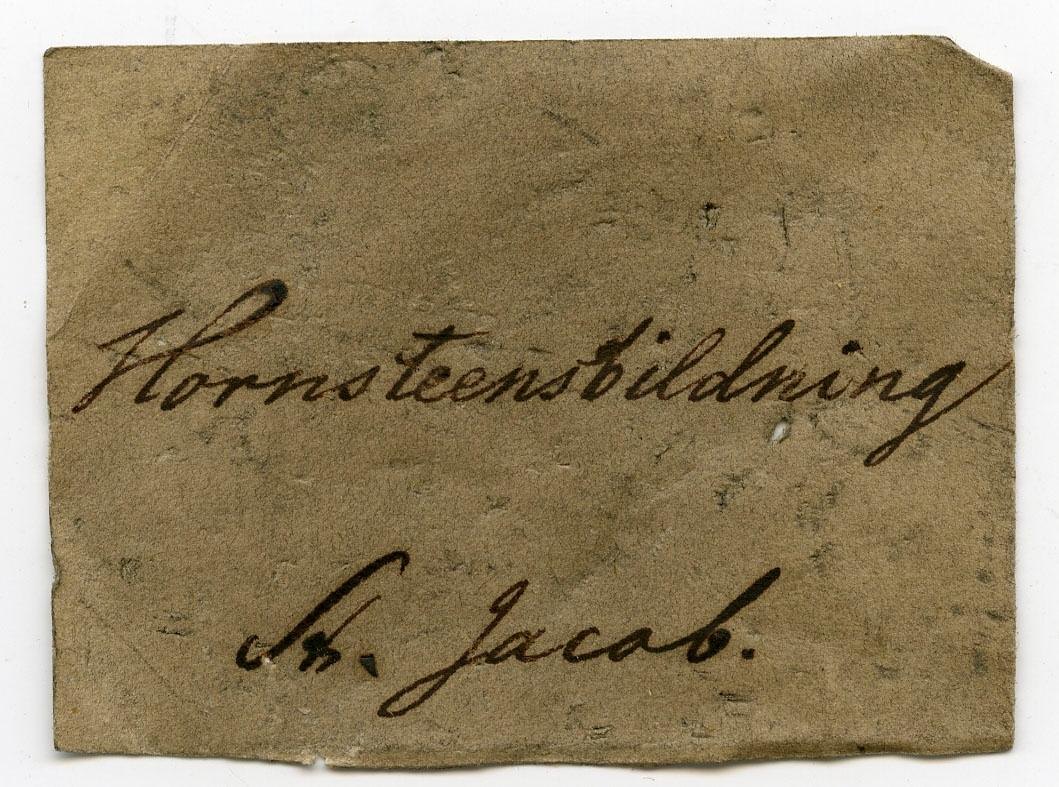 Etikett på prøve: Snt. Jacob.  Etikett i eske: Hornsteensbildning St. Jacob.