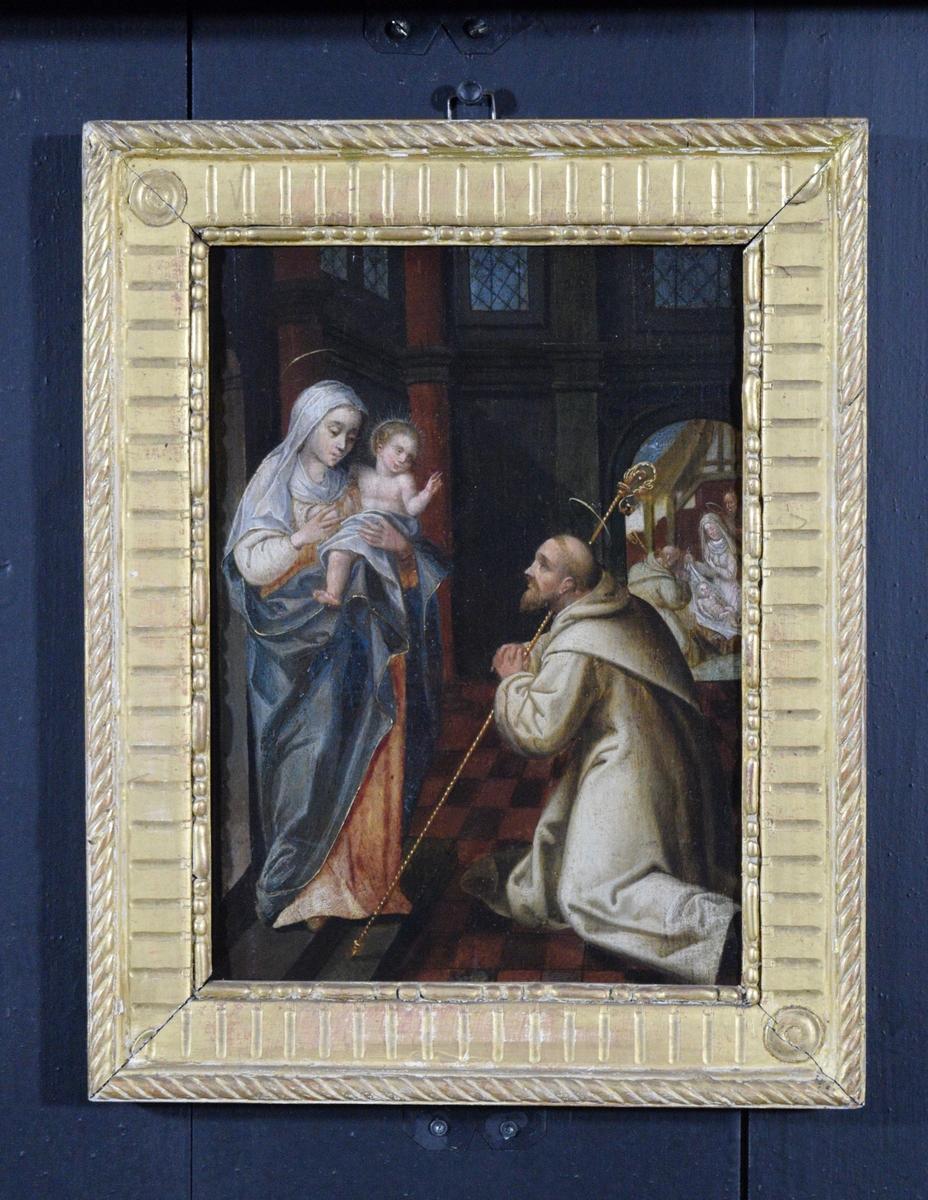 Til venstre Madonna med barnet, til høyre munk med glorie og stav. Munken kan være sankt Bernard av Clairvaux. Scenen er omgitt av arkitektoniske detaljer; søyler, høye vinduer og en port. Gjennom porten sees stallen i Bethlehem, med knelende munk, Jesusbarnet, Maria og Josef.