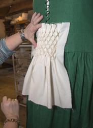 Honeycomb; en type elastisk rutemønster i stoff.