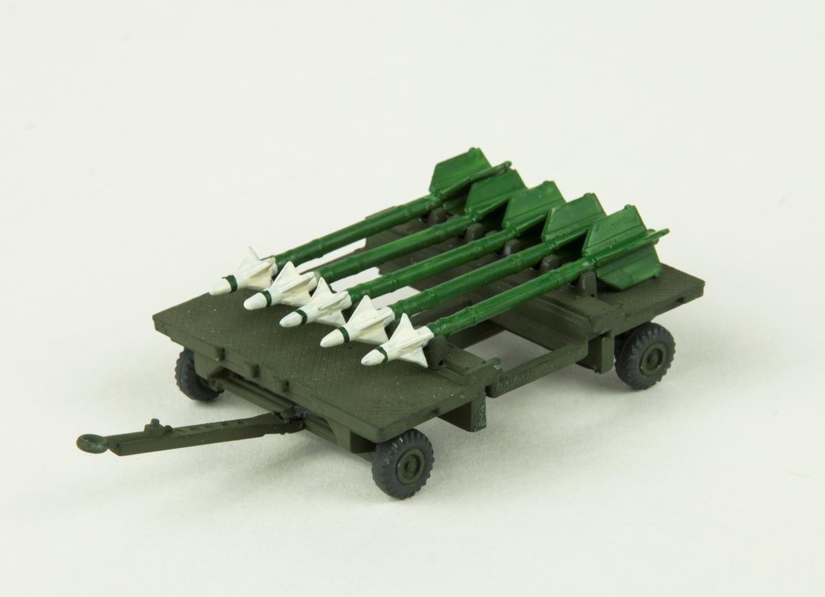 Modell skala 1:72. Vagn med en last av fem robotar.