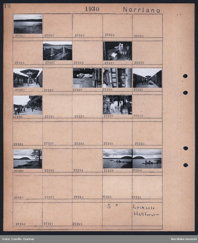 Motiv: Norrland, Lycksele; Landskapsvy med sjö och skog, bro av järn över älv, människor på perrongen på Vännäs järvägsstation, en kvinna står i dörren på en järnvägsvagn, närbild av hundar, landskapsvy över sjö med roddbåt och två kvinnor som står på en brygga och tvättar.