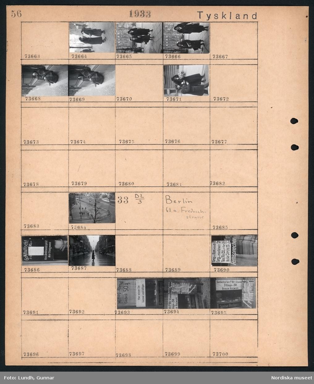 """Motiv: Tyskland, Rankestrasse, Berlin, fröken Andersson, fru Rydelius; Porträtt av två kvinnor som går på en stadsgata, en kvinna med svarta glasögon sitter i en port, stadsvy med fotgängare och en spårvagn.  Motiv: Tyskland, Berlin bl. a. Fredrichstrasse; Skyltfönster med text """"Gr. Mittagtisch! Kein Bedienungsgeld Kein Trinkzwang"""" och ett plakat uppsatt på fönstret, stadsvy med fotgängare och bilar, skyltfönster med text """"Grog von Rum ....."""" """"Fernsprechen"""", skyltfönster med text """"Mittag u. Abend Gedeck 50"""" """"Hier essen Sie besser und billiger"""" """"Speise - Restaurant"""", skyltfönster med text """"Gedecke bis 7 Uhr Abends 3 Gänge - 50 Grosse Auswahl."""""""