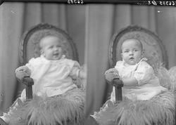 Portrett. Et lite barn. Bestilt av Fru Ruth Halvorsen. Rosse