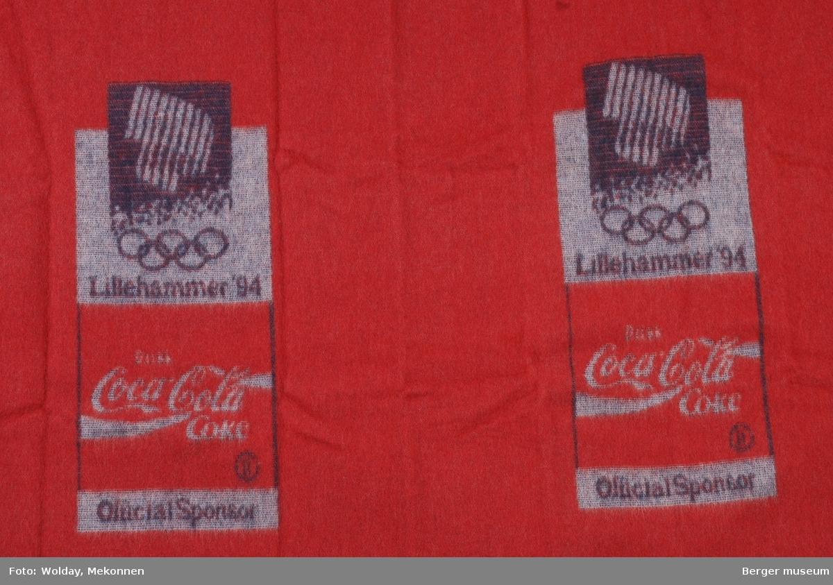 Lite ullpledd med OL Lillehammer, OL-ringer Coca Cola logo, og Official Sponsor.