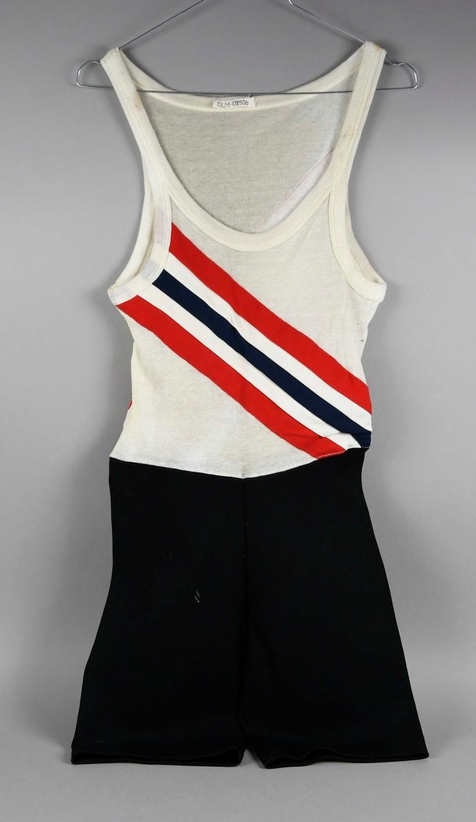 Roerdrakt som består av en svart buske av nylon og hvit ull-overdel med rød og blå diagonal stripe på ryggen og brystet.