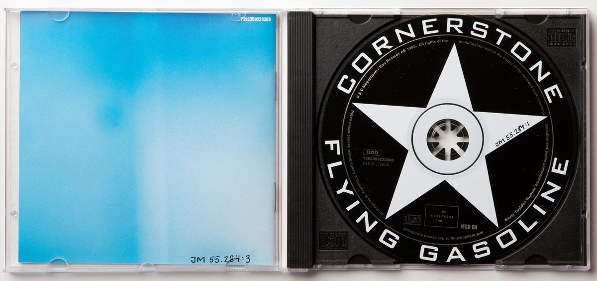 """CD-skiva med musik med gruppen Cornerstone. Skiva i tredelat, hårt plastfodral med booklet (häfte) i framsidan och inlaga i baksidan. Framsidan har ett fotografi av gruppen. På framsidan sitter två oranga prislappar märkta """"Kr 50.00"""" och """"10.00"""".  Innehåll: 1. Torn of led 2. Walk and talk 3. Sweet feeling 4. Water 5. Leaving 6. Evacuation day 7. Blue eyes 8. Moving up 9. Send down the rain 10. Blood on the ground 11. Wild fire 12. 4 a clock blues 13. Whiskey and women  JM 55284:1, Skiva JM 55284:2, Fodral JM 55284:3, Booklet"""