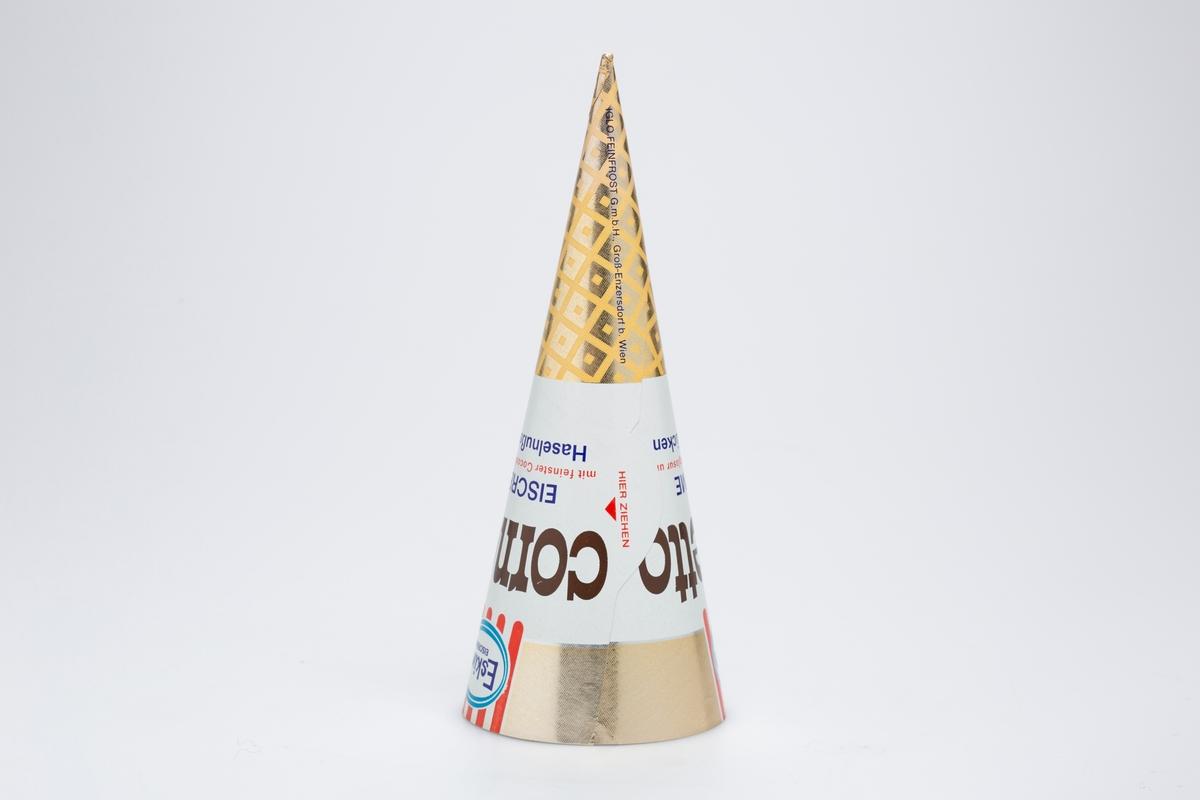 Kjegleformet iskrempapir (kremmerhus) i aluminium. Kremmerhuset er blankt med farger på utsiden, og matt uten farge (hvitt) på innsiden. Det har trykket logo, mønster og tekst i rød, blå, hvit, gull og brun. Det har hvitt felt i midten med tekst. Spissen og kanten er i gull. Kremmerhuset er produsert for Eskimo eiscreme.