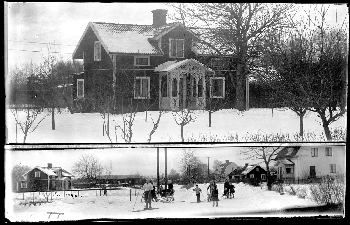Barn på skidor framför bostadshus