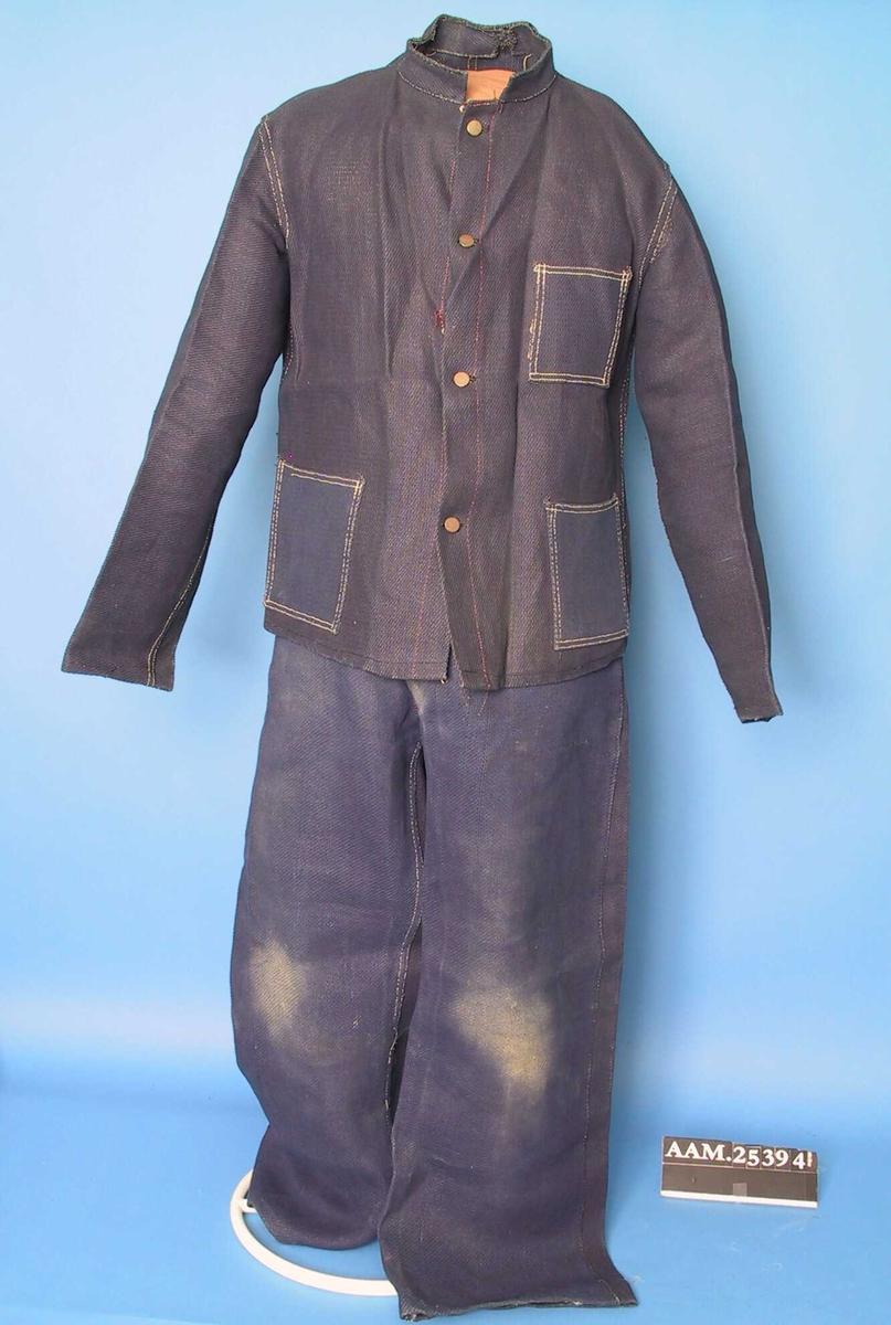 0df7c2e9 Drakt, arbeidsklær, bukse og jakke. Sydd av tøy som er vevd av papirtråder