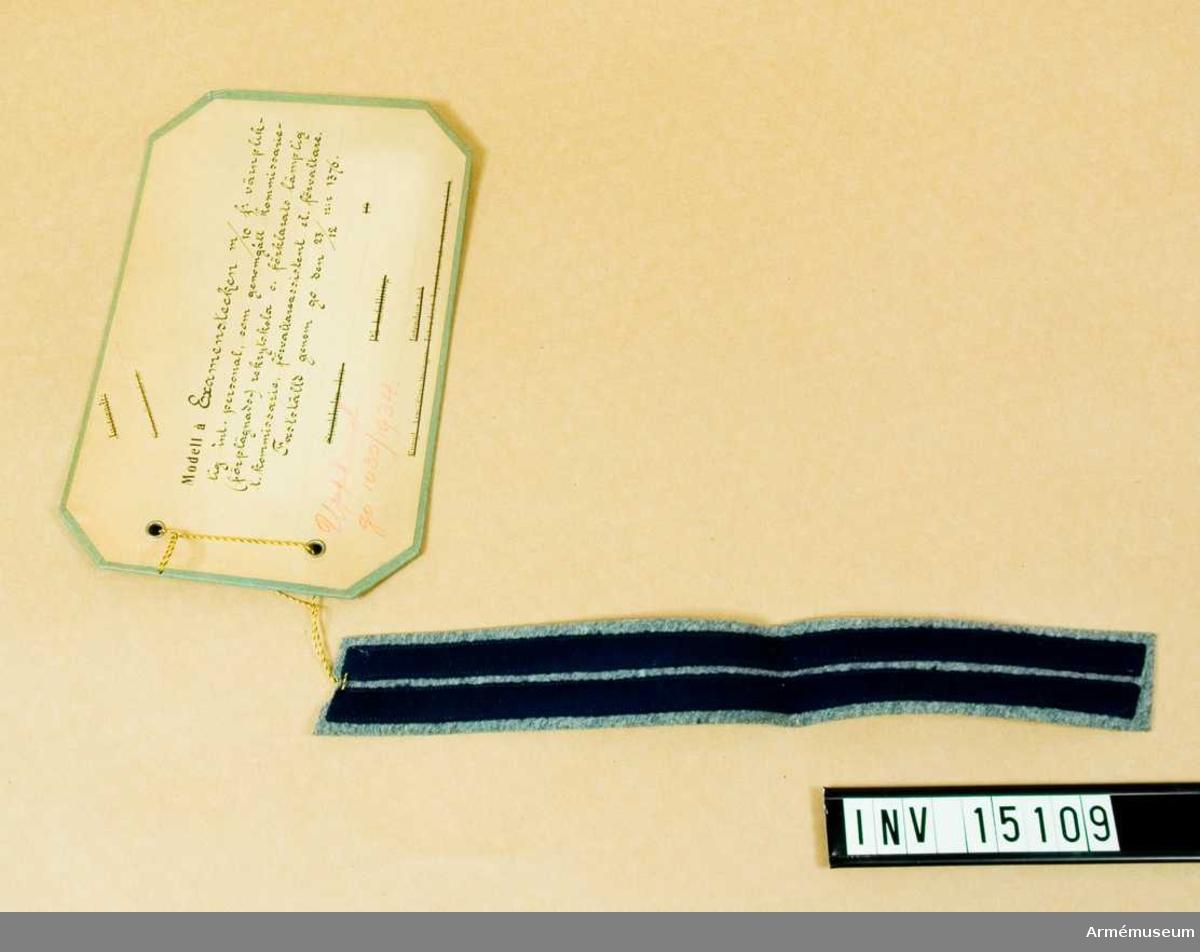 Grupp C I.  Modell å examenstecken m/1910 för värnpliktigt int. personal, som genomgått kommisarie- (förplägnads) rekrytskola och förklarats lämplig till kommissare, förvaltarassistent eller förvaltare. Fastställd genom go nr 1376 den 23. december. Upphävd go 1030/1934.