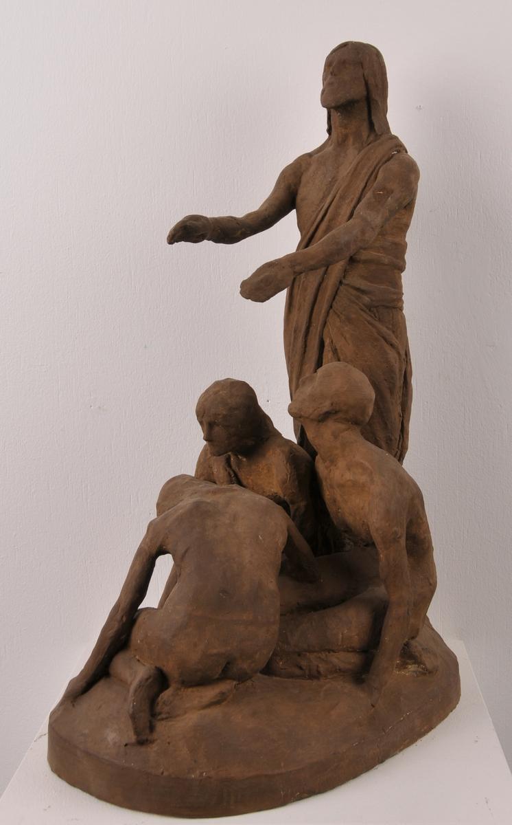 Ei gruppe som sit på kne, medan Kristus står og held hendar over dei, truleg til helbreding eller velsigning.