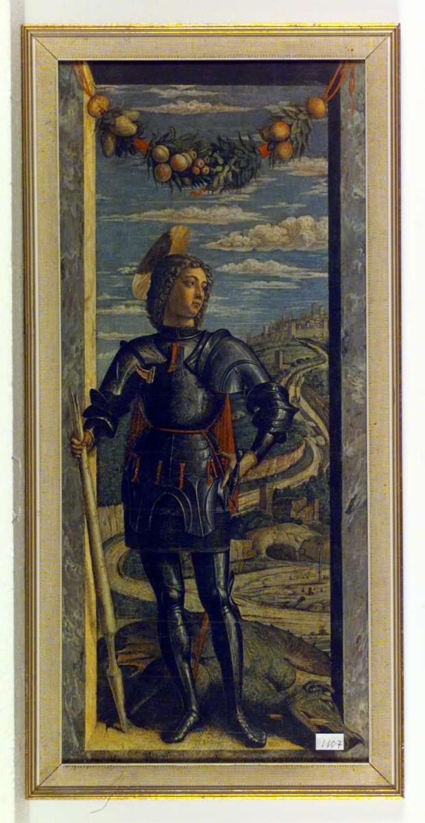 St. Georg står med draken ved sine føtter. I bakgrunnen et italiensk landskap.