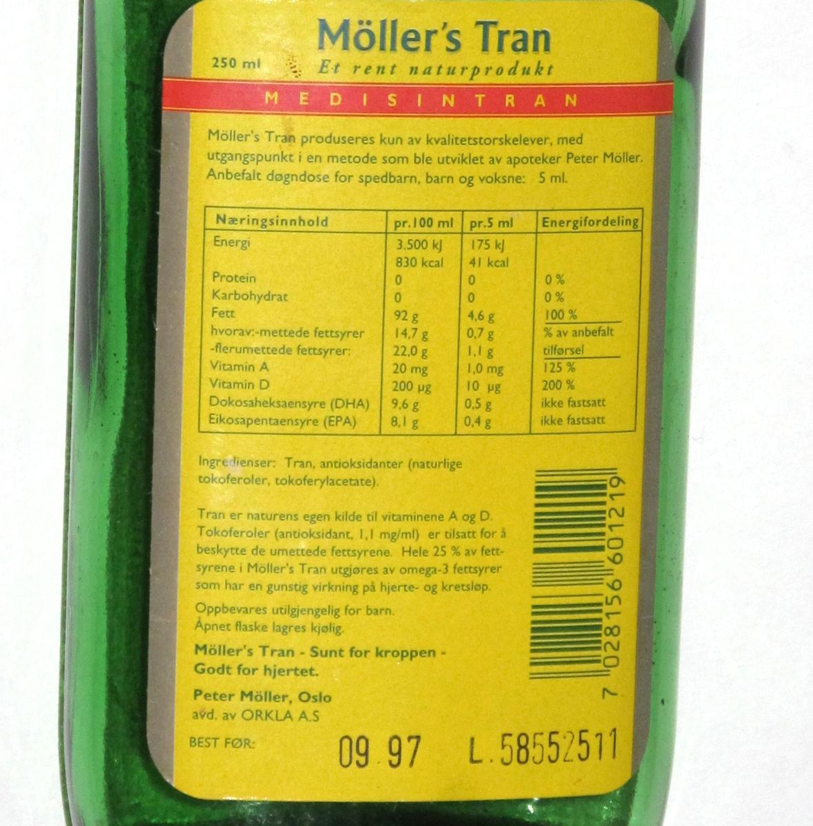 Flaske av grønnfarget glass, med gul etikett, til  tran. 250 ml.  Etikett med opplysninger om  innhold og oppbevaring, varemerke, utmerkelser og strekkode.