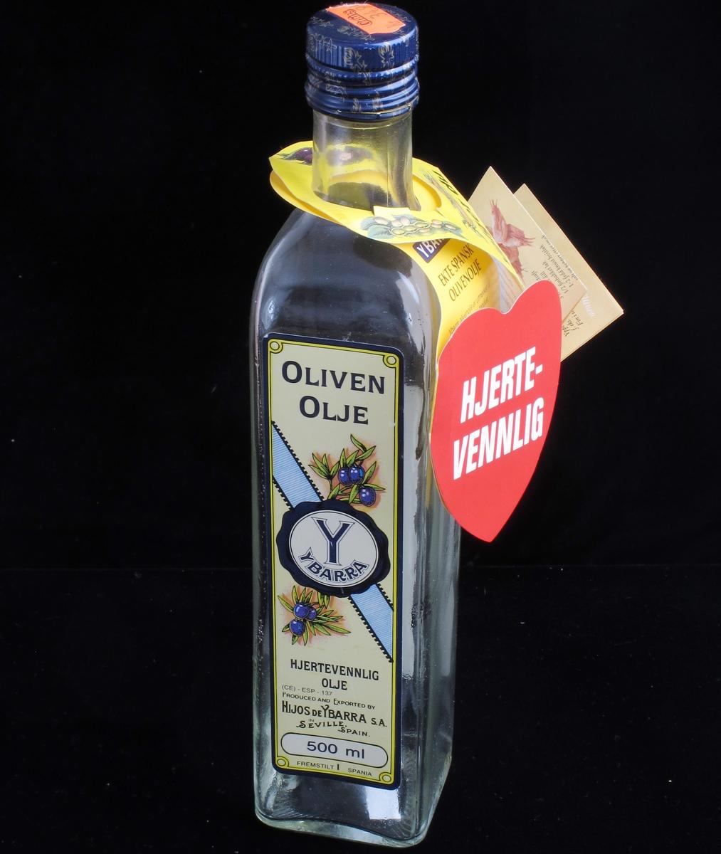 Flaske for olivenolje. Skrukork. Informasjon på papir hengt om flaskehalsen.